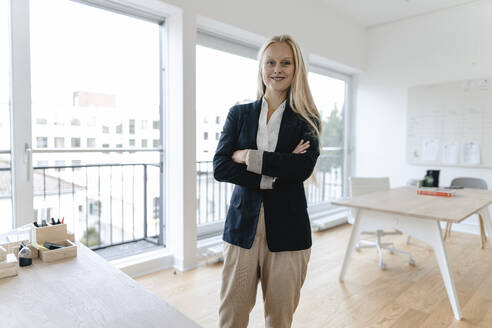 Portrait of a smiling young businesswoman in office - GUSF03219