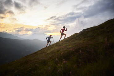 Man and woman running uphill in the mountains - CVF01525