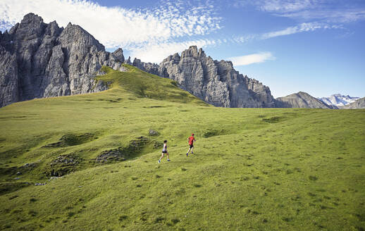 Man and woman running in the mountains - CVF01537