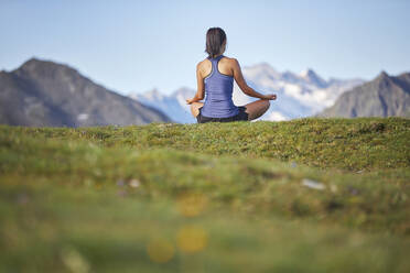 Woman meditating in the mountains, rear view - CVF01558