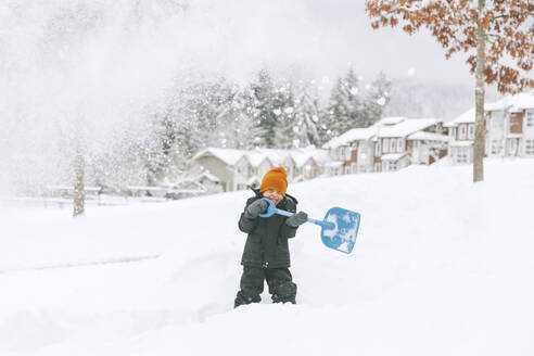 Canada, British Columbia, Vancouver, boy shovelling snow, winter fun - CMSF00074