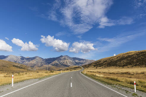 New Zealand, Clouds over empty State Highway 73 with mountains in background - FOF11552