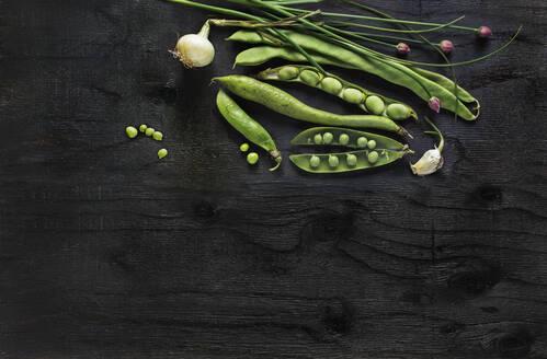 Root vegetables on black background - JOHF06052