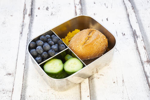 Lunch box with cucumber slices, blueberries and bun with lentil paste - LVF08548