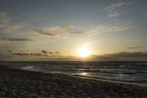 Germany, Mecklenburg-West Pomerania, Prerow, Sandy coastal beach of Baltic Sea at sunset - STBF00535