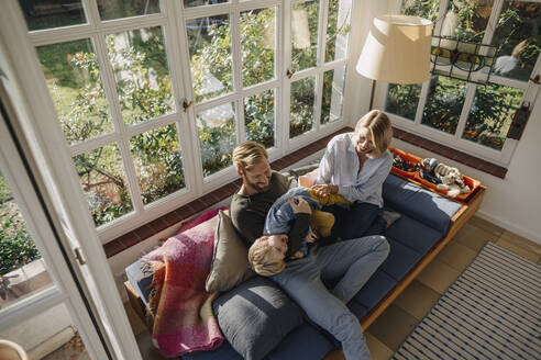 Happy family in sunroom at home - KNSF07003