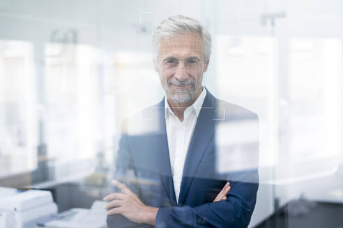 Portrait of businessman with grid over his face - KSHSF00028