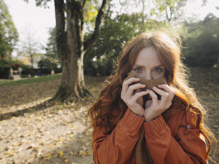 Portrait of a redheaded woman in a park in autumn - KNSF07156
