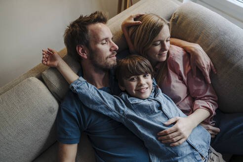 Happy family relaxing on couch - KNSF07274