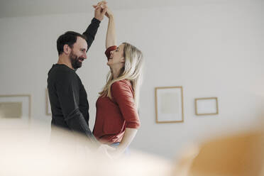 Happy couple dancing at home - KNSF07295