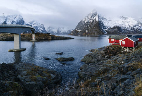 Bridge and red huts at the coast, Hamnoy, Lofoten, Norway - DGOF00102