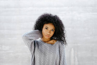 Portrait of a beautiful young woman wearing knit pullover - TCEF00084