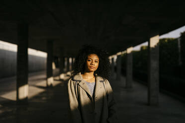 Portrait of a young woman in a parking garage - TCEF00087