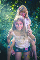 Portrait of two girls celebrating Festival of Colours - SARF04451