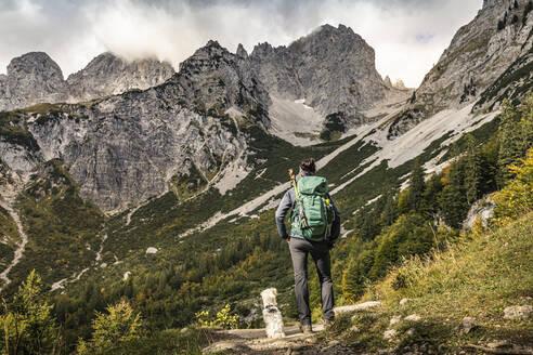 Woman on a hiking trip at Wilder Kaiser enjoying the view, Kaiser mountains, Tyrol, Austria - MSUF00168