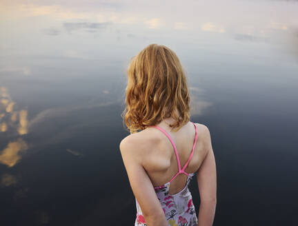 Girl standing at sea - JOHF06431