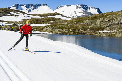 Man cross-country skiing in mountains - JOHF06718