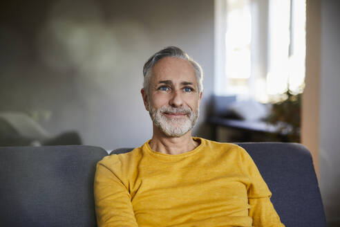 Portrait of confident mature man at home - FMKF06100