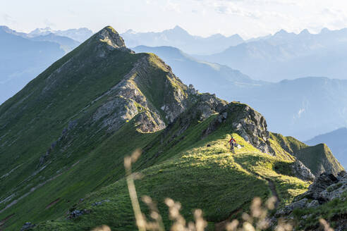 Mountainbiker on a way on a ridge, Grisons, Switzerland - HBIF00008