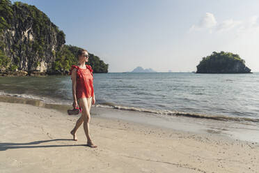 Woman walking on the beach, Noppharat Thara Beach, Ao Nang, Krabi, Thailand - CHPF00603