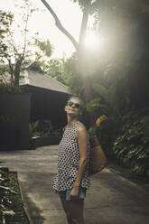 Woman in a tropical garden, Nai Thon Beach, Phuket, Thailand - CHPF00615