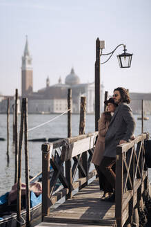 Young couple at the waterfront in Venice, Italy - MAUF03260