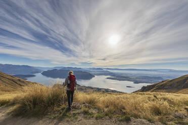 Woman hiking at Roys Peak, Lake Wanaka, New Zealand - FOF11841