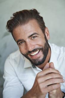Portrait of happy businessman wearing white shirt - PNEF02317
