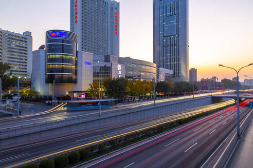 Traffic trail lights on major road near Beijing Zoo at dusk, Beijing, People's Republic of China, Asia - RHPLF13729