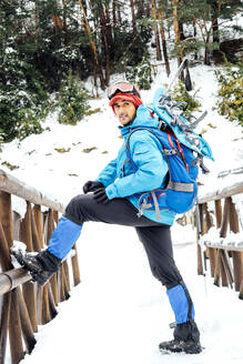 Man standing on a bridge in snow - CJMF00251