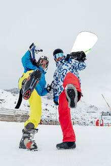 Portait of happy skier and snowboarder in ski area - CJMF00254