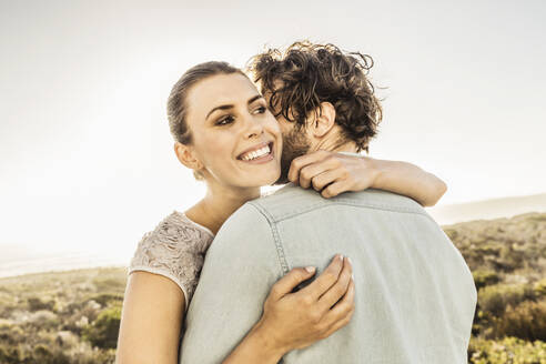 Happy young couple hugging at the coast in summer - SDAHF00139