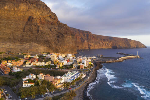 Spain, Canary Islands, La Gomera, Valle Gran Rey, Aerial view of Vueltas and port at sunse - SIEF09505