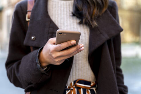 Close-up of woman holding smartphone - AFVF05313