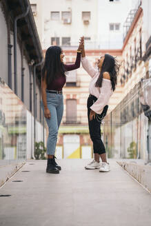 Two happy young women having fun in the city - MPPF00504