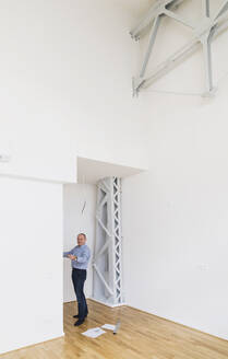 Man checking specifications of refurbished kuxury loft - GWF06446