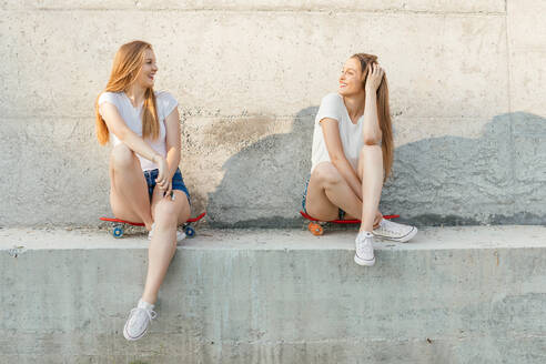 Two happy teenage girls outdoors - CAVF74730