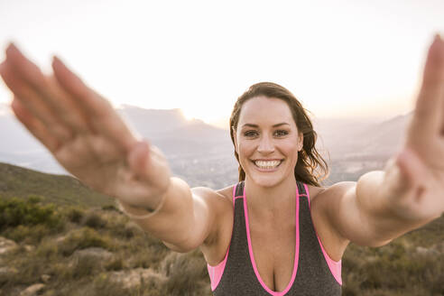 Portrait of happy Plus-Size-Model doing sports in the countryside at sunset - SDAHF00205