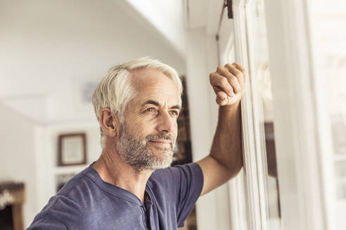 Portrait of mature man looking out of window - SDAHF00340