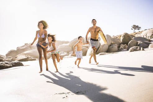 Happy family running on the beach - SDAHF00458