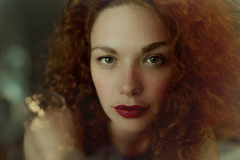 Portrait of red-haired woman looking at camera - OGF00119