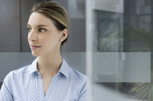 Portrait of a confident young businesswoman in office looking away - BMOF00191