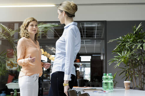 Two businesswomen having a meeting in office - BMOF00197