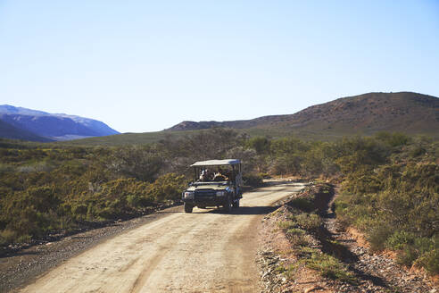 Safari off-road vehicle on sunny emote dirt road South Africa - CAIF24038