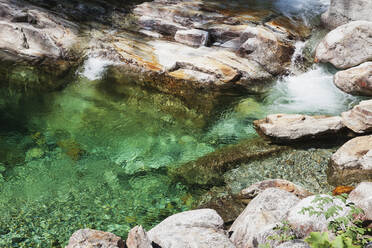 Stones and rocks in clear turquoise waters of Verzasca river, Verzasca Valley, Ticino, Switzerland - GWF06463