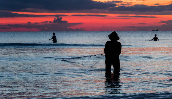 A fisherman is fishing at Sunset on Koh Rong, Cambodia - CAVF75241