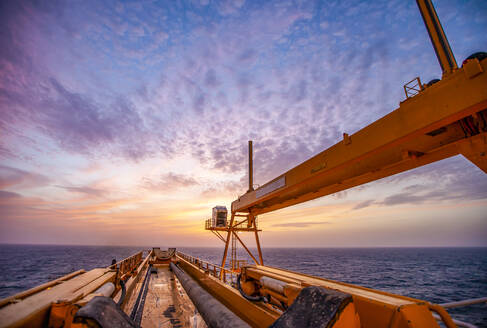 Offshore Drilling during sunset in the Gulf of Mexico - CAVF75325