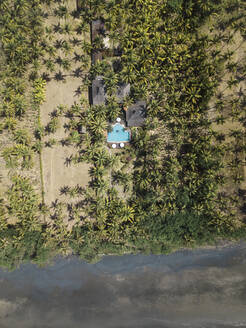 Aerial view of house with pool near the beach - CAVF75447