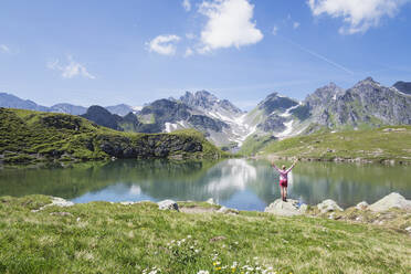 Switzerland, St Gallen Canton, Glarus Alps, Woman looking at Wangs Lake - GWF06481