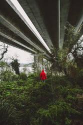 Man under a highway bridge in abandoned environment - RAEF02354